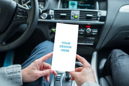 DL - 99x210mm brochure in the hands of a driver