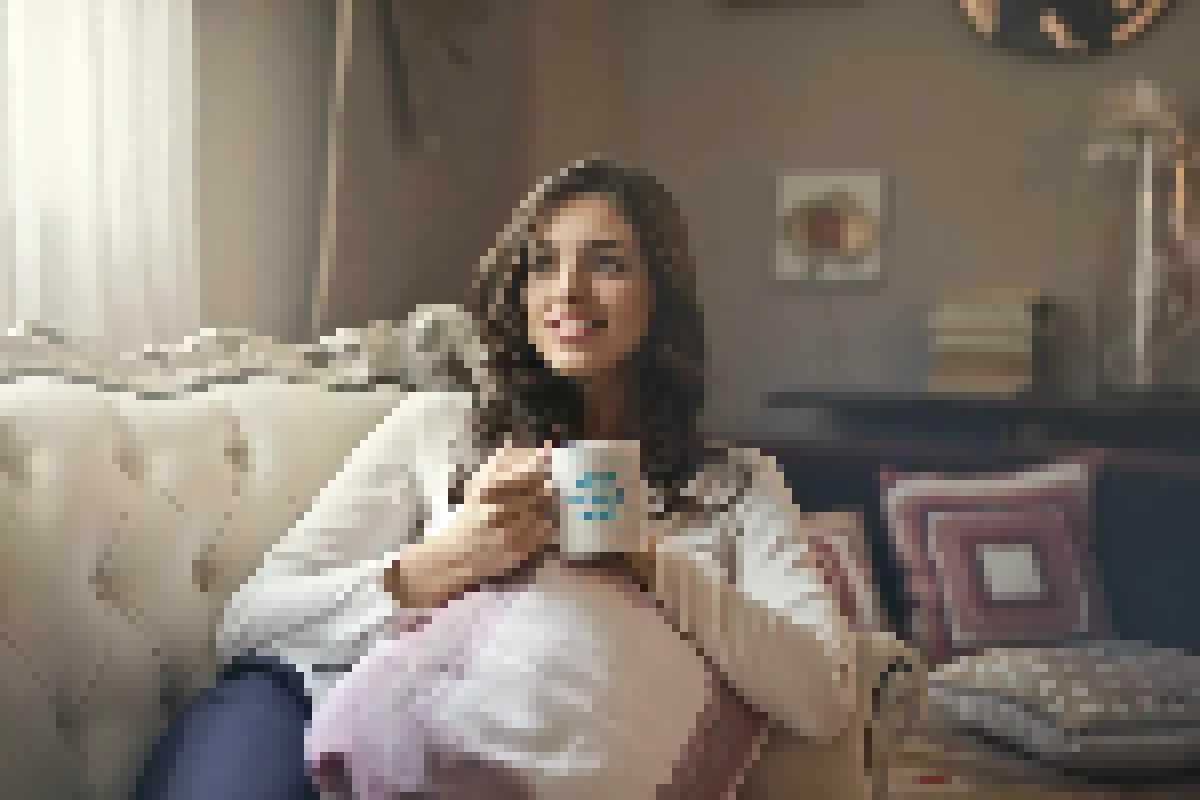 Ceramic mug in the hand of brunette woman