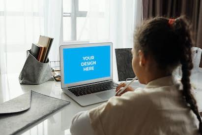 African-American taking online classes on MacBook Air