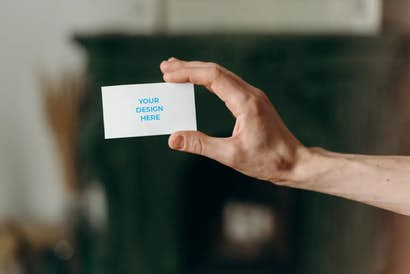 Business card in the hand of a man