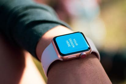 Pink Apple Watch on the hand