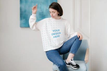 Brunette woman wearing a sweatshirt sitting on the chair