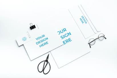 Branding near the scissors and glasses